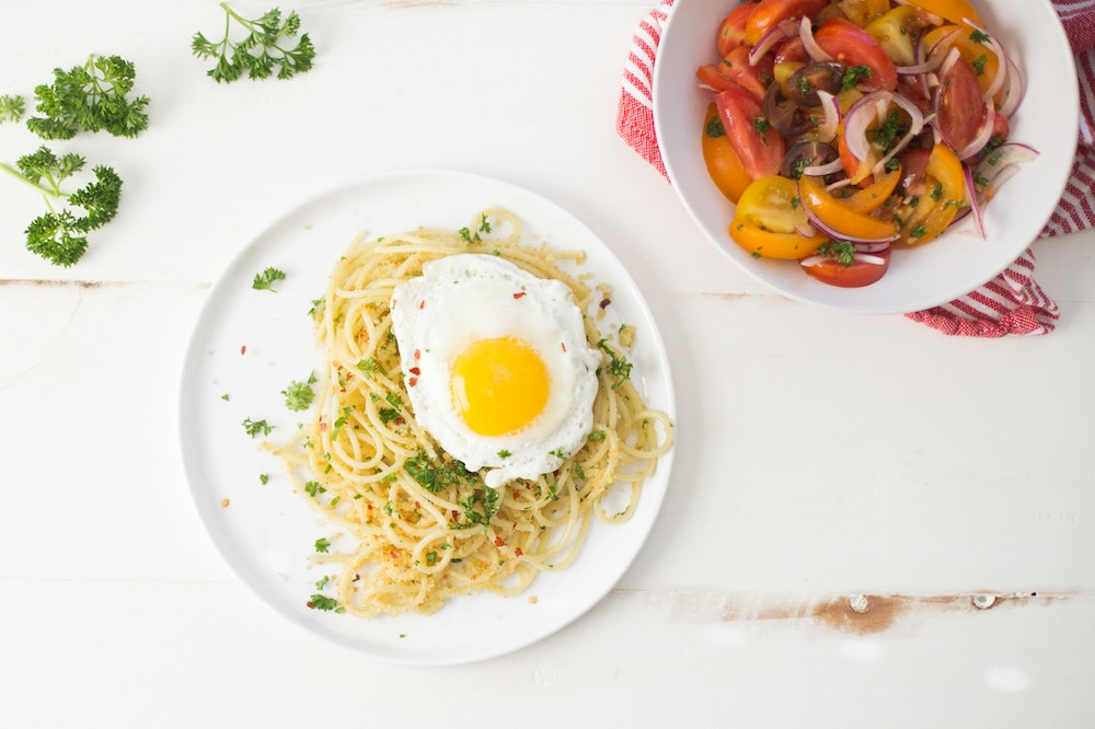 Zucchini Noodles with Anchovies and Fried Eggs