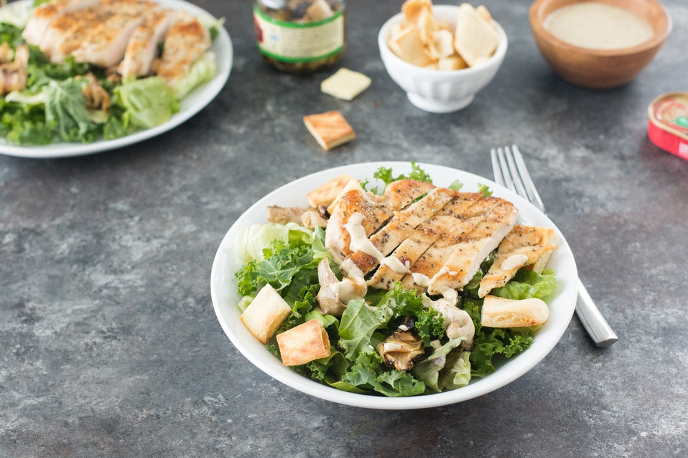Lemon-Pepper Chicken over Kale Caesar Salad