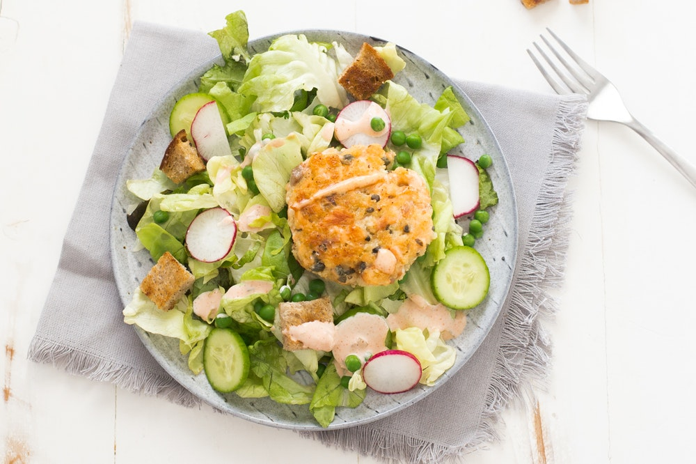 Salmon Cakes over Spring Salad