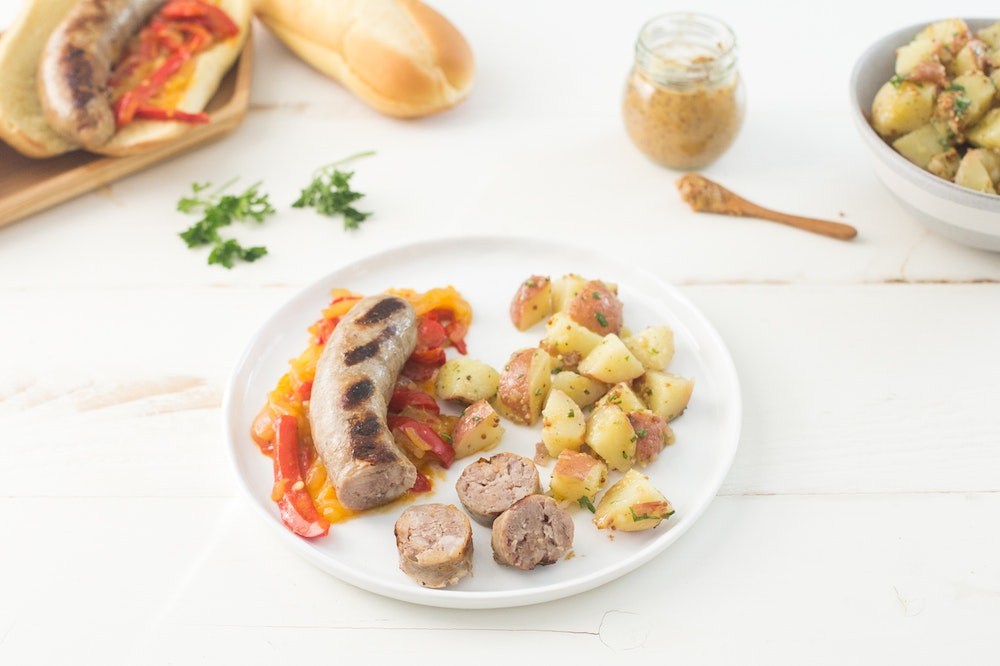 Beer Simmered Brats with Peppers and Onions