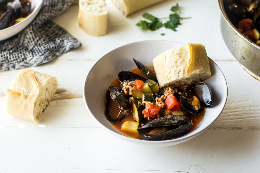 Cajun Mussels with Sausage and Zucchini
