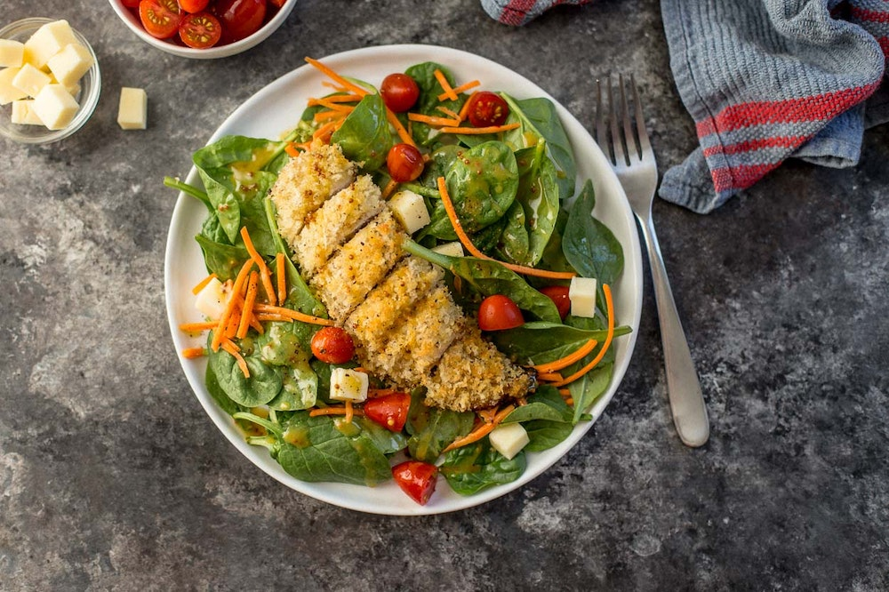 Baked Chicken Tenders over Baby Spinach