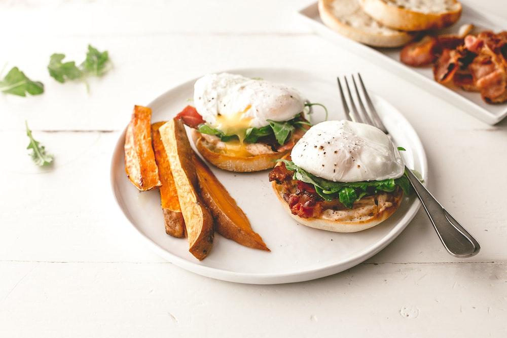 Bacon and Arugula Eggs Benedict