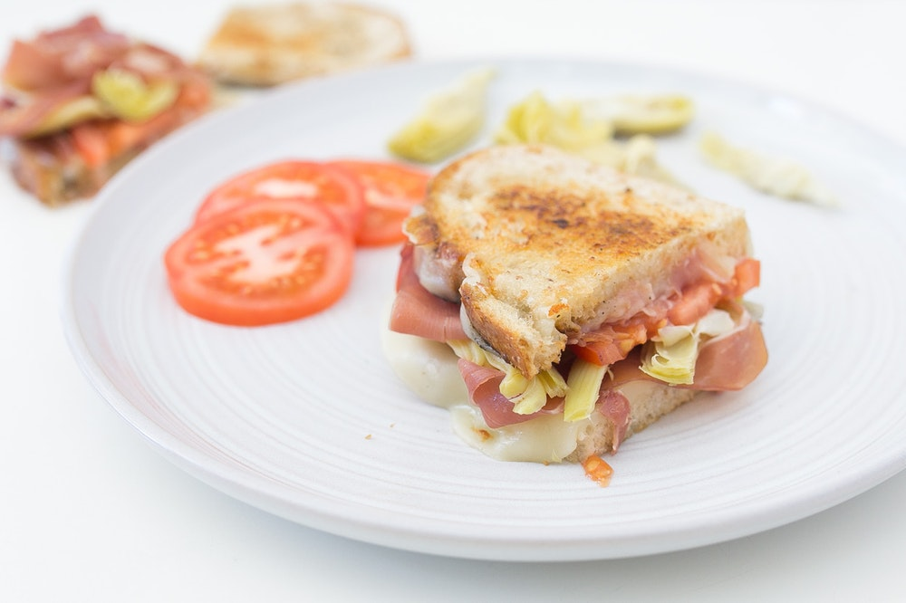 Mediterranean Grilled Cheese with Prosciutto, Artichokes, and Tomatoes